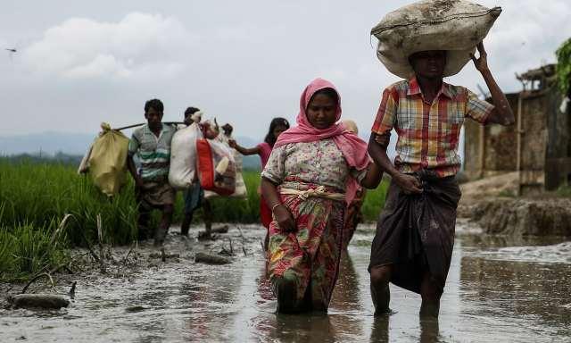 https://www.theguardian.com/world/2017/sep/10/myanmar-accused-of-planting-landmines-in-path-of-fleeing-rohingya#img-1